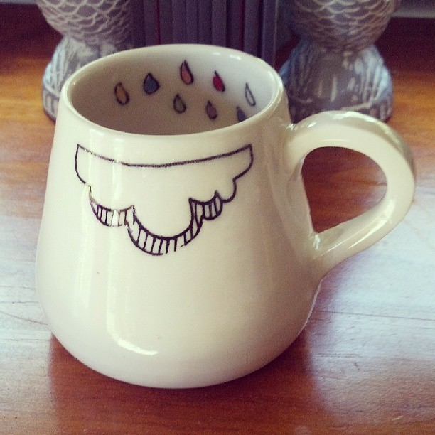 handmade mug with cloud and rain