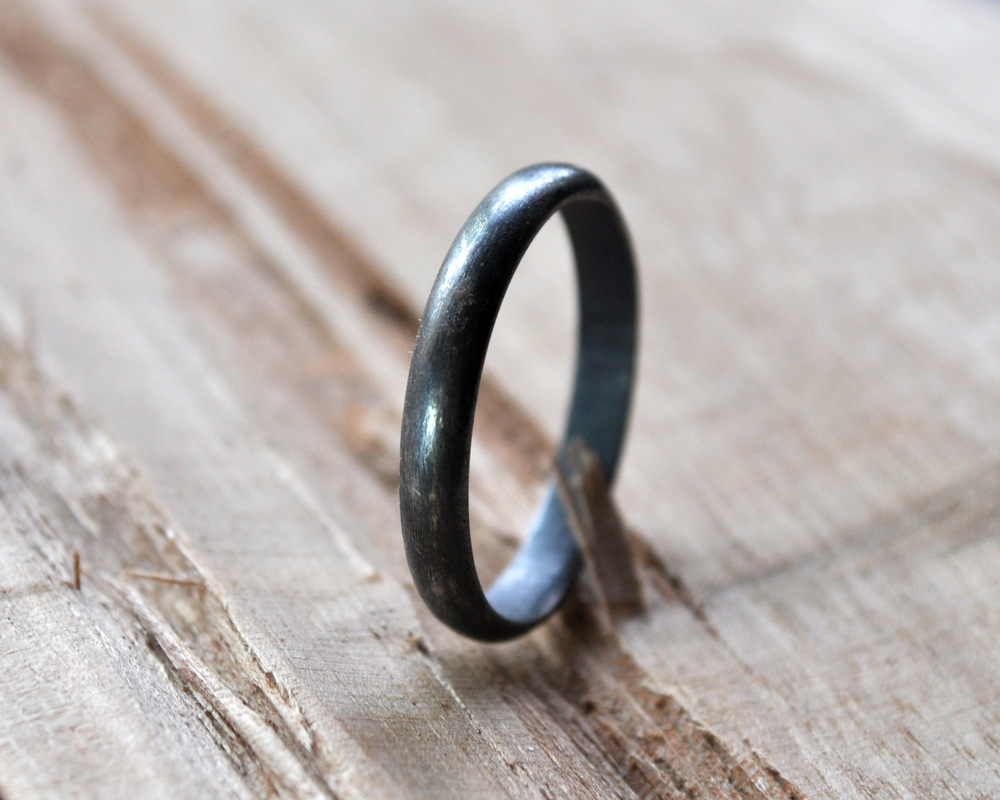 Partially worn oxidised ring (1)