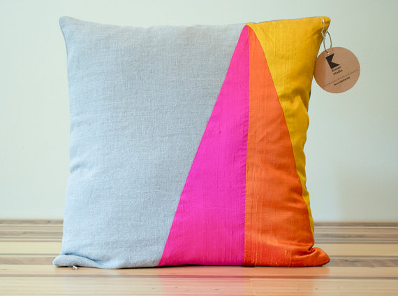 cushion with neon triangles