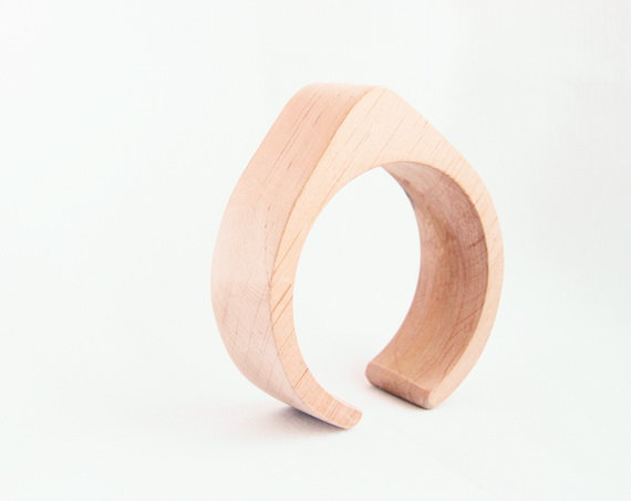 wooden ring with triangle top